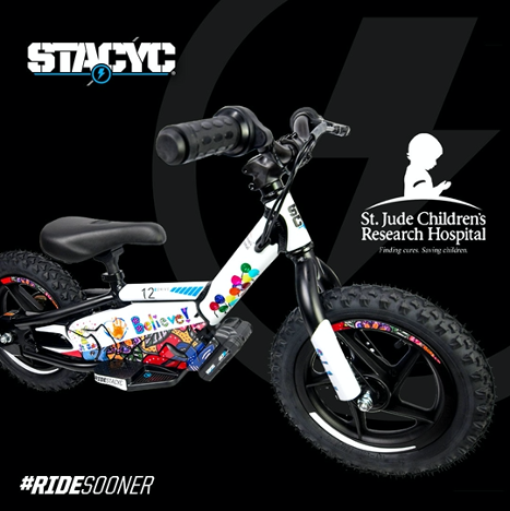 "This one-of-a-kind StaCyc 12 E Drive bike with custom ""Believe"" patient-inspired artwork is one of over 90 custom items that fans can bid on in the Supercross This Race Saves Lives St. Jude online auction. Fans can bid on this bike through Monday, May 4. Photo courtesy of StaCyc."